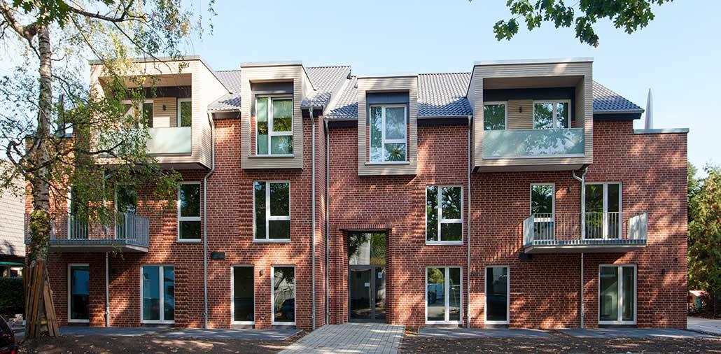 Ansicht von Straßenseite - Mehrfamilienhaus mit 14 Wohneinheiten für Singles und Familien